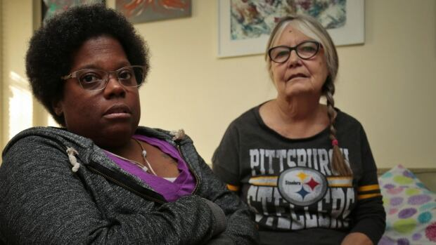 Sally Thomas, left, says she depends on Carefor's personal support workers to live a safe and active life. She and her mother, Sandra MacDonald, say she's had to fight every day to receive those services since being discharged from hospital last Tuesday.