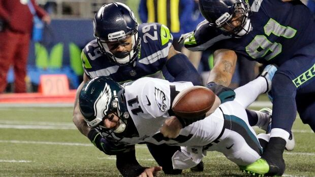 Seattle's Earl Thomas forces Philadelphia QB Carson Wentz to fumble during the Seahawks' 17-3 win over the Eagles on Sunday.