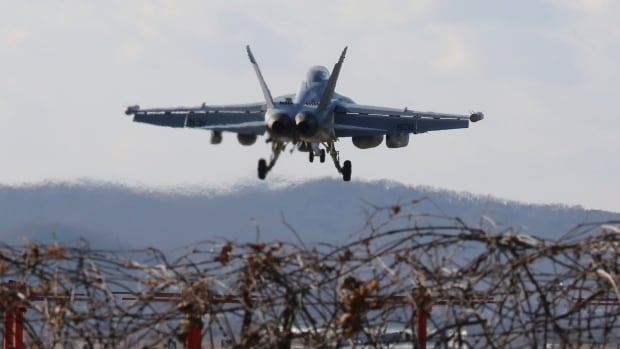 A U.S. air force EA-18G Growler fighter jet prepares to land at the Osan U.S. Air Base in Pyeongtaek, South Korea, on Monday. Hundreds of aircraft including two dozen stealth jets began training Monday as the United States and South Korea launched their biggest-ever combined air force exercise.