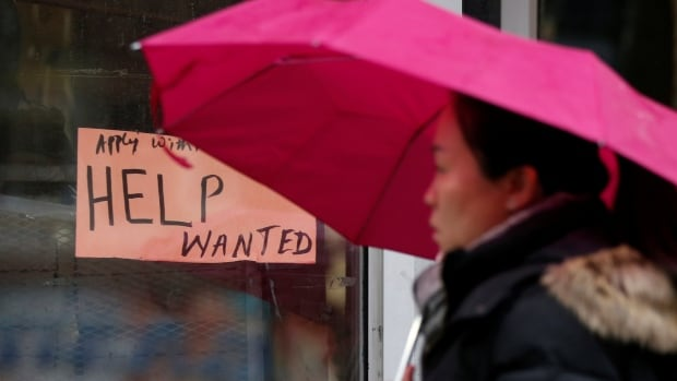 A woman walks past a help wanted sign in Ottawa. Statistics Canada reported Friday that the national unemployment rate rose to 5.9 per cent in January.