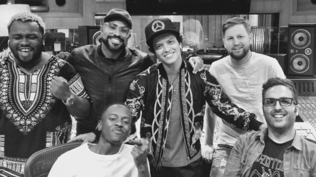 "Charles Moniz (bottom right) is seen here in studio with Bruno Mars (centre). Moniz is up for multiple Grammy Awards this year for his work on ""24K Magic."""