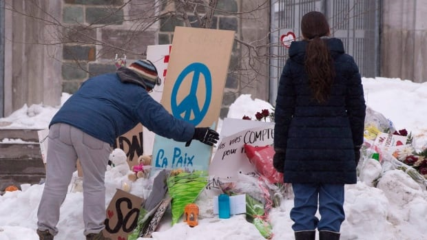 People payed their respects at a makeshift memorial near the Grande Mosquee de Quebec days after the Jan. 29 shooting.