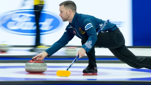 Skip Brad Gushue throws a stone during Olympic curling trials on Monday.