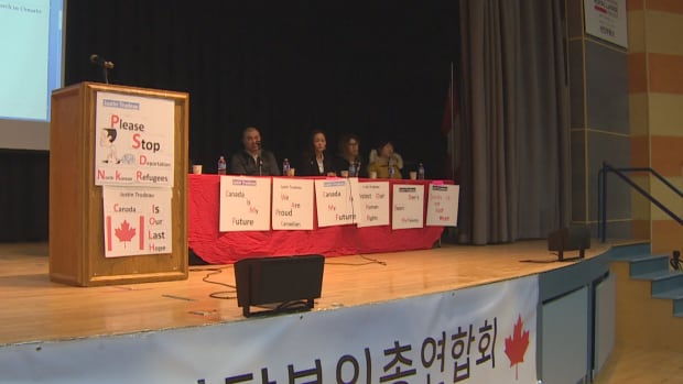 Refugees shared their stories on stage at the Korean Canadian Cultural Association Monday night.