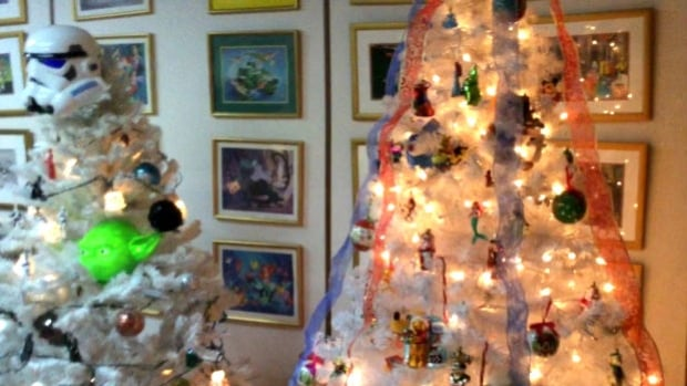 The couple has 90 Christmas trees in their home in Red Deer, Alta.