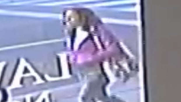 Police have released security camera footage of a suspect after a woman allegedly tried to grab a toddler from another woman's arms on Sat., Dec. 2.