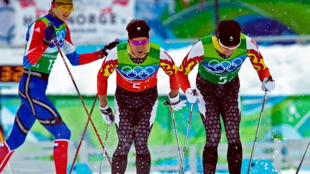 Canada's Alex Harvey, right, is tagged by teammate Devon Kershaw in the men's team sprint cross country skiing event at the 2010 Vancouver Olympic Winter Games. The Canadians finished fourth, while a Russian pair took gold.