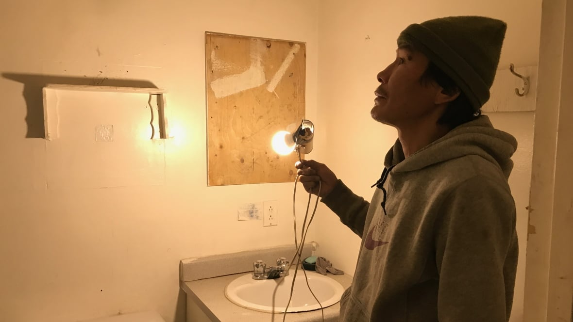 Living with limited running water, one light bulb and a wood stove in Fort Good Hope, N.W.T.
