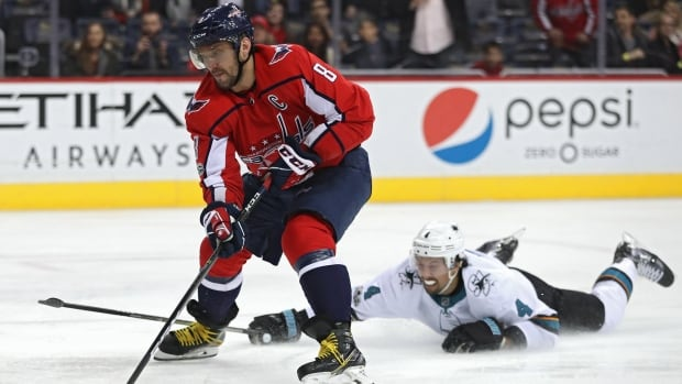 San Jose Sharks' Brenden Dillon, right, was given a major penalty and game misconduct for slashing Washington Capitals' Madison Bowey on Monday.