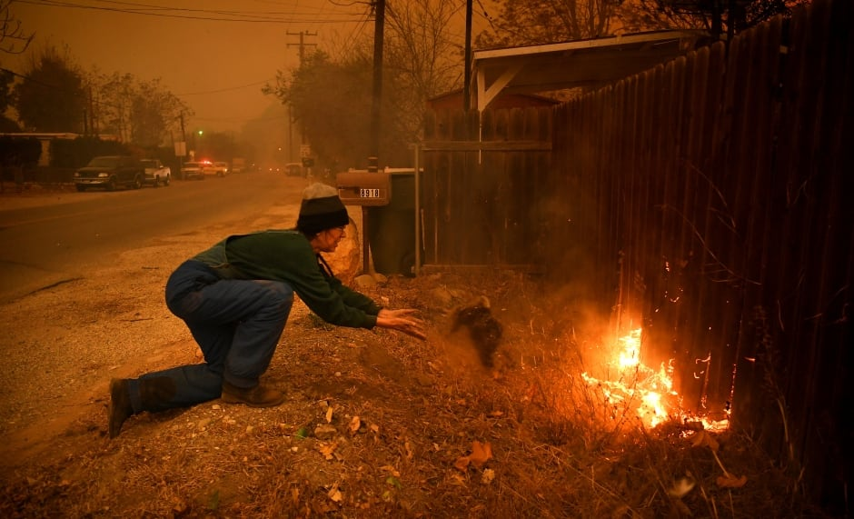 California wildfire woman tries to save her house