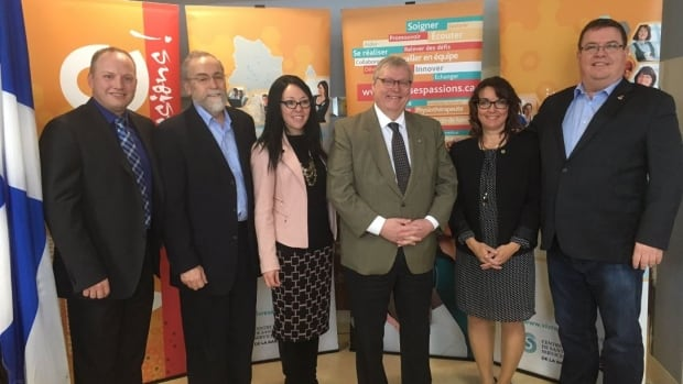 Quebec Health Minister Gaétan Barrette, third from right, announced $4.8 million in upgrades to a local hospital in Chibougamau. Barrette made the announcement with the  MP for Ungava, Jean Boucher, far right.