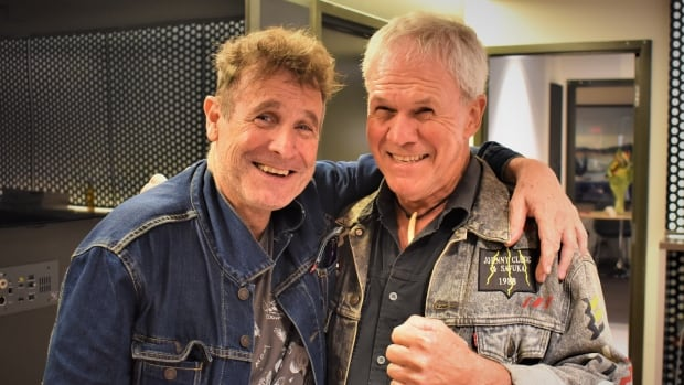 Ottawa musician Derek de Beer, right, is heading to South Africa in January to be reunited with his former bandmate Johnny Clegg, left.