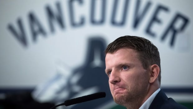 Vancouver Canucks' forward Derek Dorsett, who had to retire from playing hockey recently due to medical reasons, pauses while speaking during a news conference on Wednesday.