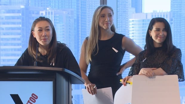 The lead organizers of the #AfterMeToo symposium, from left, filmmaker Aisling Chin-Yee,  actor-producer Freya Ravensbergen and actor Mia Kirshner, speak at the event in Toronto on Wednesday.