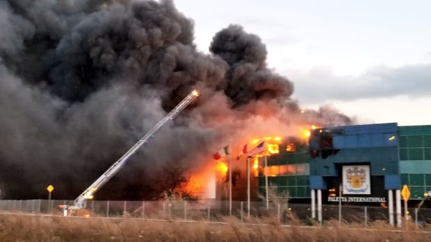 Burlington industrial building engulfed in massive fire