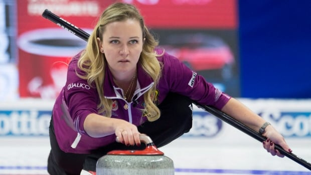 Skip Chelsea Carey, from Calgary, Alta., throws a rock during Olympic curling trials action against Team Jones. Carey played the pivotal match just days after her grandfather died.