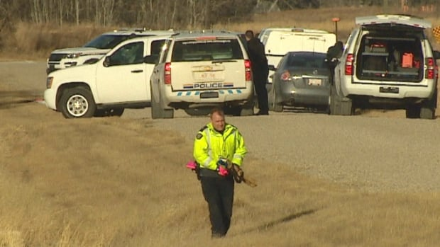 RCMP search the area after a body was found around 8:30 a.m. on Dec. 6.