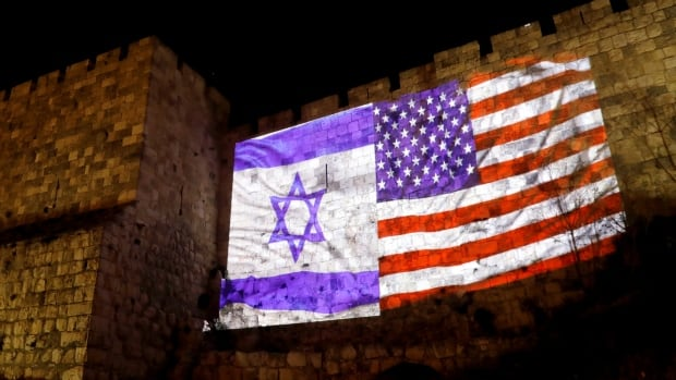 Israeli and U.S. flags are projected on part of the walls surrounding Old Jerusalem Wednesday.