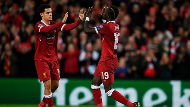 Liverpool midfielder Sadio Mane, right, celebrates scoring his team's sixth goal with Philippe Coutinho, left, during their 7-0 win over Spartak Moscow on Wednesday.