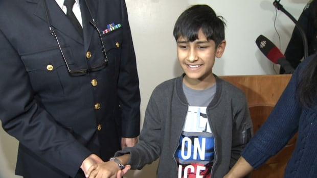Saajin Mann, 10, received his MedicAlert bracelet as the West Vancouver Police Department announced its partnership with the emergency service provider.