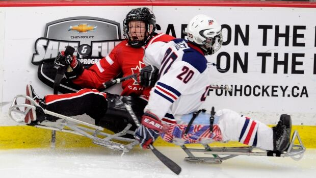 Canada's Billy Bridges, left, is hit by USA's Adam Page in a game in 2012. On Wednesday, Bridges scored Canada's only goals in a 5-2 loss to the Americans.