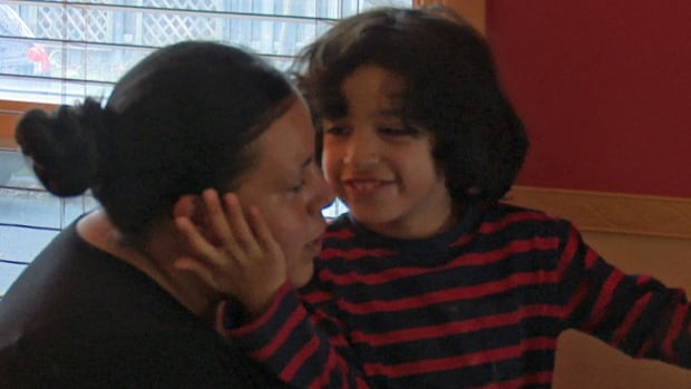 Amari Rubio, right, and his mother Claudia play at their home. Claudia worries her son won't be able to participate in the Bruce Awad Summer Program for kids with autism because of the long wait list.
