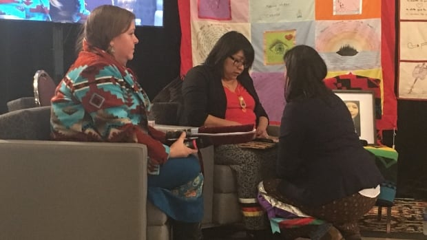 National Inquiry into Murdered and Missing Indigenous Women and Girls lawyer Christa Big Canoe (left) just before the hearing of Anita Ross (centre) whose daughter Delaine Copenace, 16, was found dead in Lake of the Woods in Kenora, Ont., on March 22, 2016. Ross is speaking to Inquiry Commissioner Michele Audette before she begins her testimony.