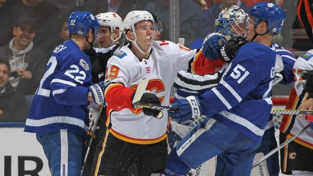 The Flames' Matthew Tkachuk, middle, was suspended one game on Thursday for unsportsmanlike conduct, stemming from a spearing incident during Wednesday night's shootout loss in Toronto.
