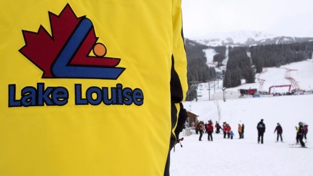 A 17-year-old ski racer from a club in Germany has died in a Calgary hospital after he was seriously injured during a Nor-Am Cup event in Lake Louise, Alta. In this photo, a Lake Louise guest host directs skiers off the mountain after a power failure before the women's World Cup downhill a few days earlier. Several women crashed during that event, including American Lindsey Vonn.