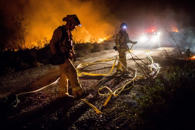 USA CALIFORNIA WILDFIRES Firefighters extinguish Thomas Fire