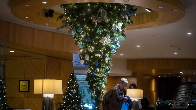 an upside down christmas tree is suspended from the ceiling at the fairmont vancouver airport hotel in richmond bc darryl dyckcanadian press