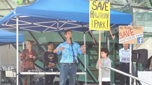 Steven Pettigrew speaks at a Save Hawthorne Park rally in Surrey.