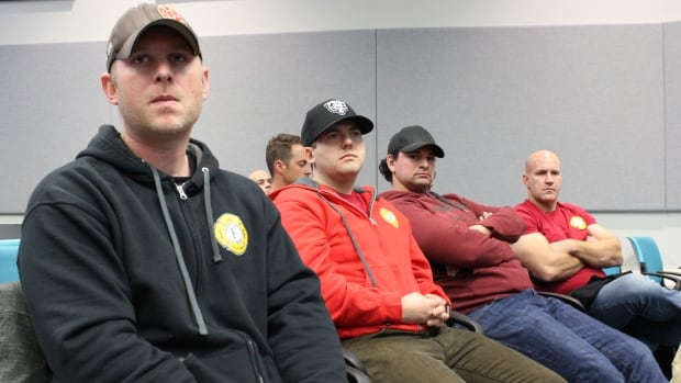 Lt. Adam Catcher, senior firefighter Justin Zawyrucha, Lt. Deiter Andre, and senior firefighter Jamie Stringer observe budget deliberations in Yellowknife on Dec. 6. Stringer, who is also the vice president of the local firefighters union, says they prepared for the worst, but the decision is a win for everybody.