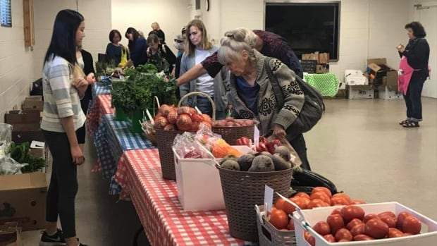 Jasper Place Wellness Centre, near 156th Street and Stony Plain Road, is looking into opening a permanent community food centre in west Edmonton for residents struggling to afford nutritional food. Shown is low-cost food market at a community league.