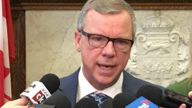 Saskatchewan Premier Brad Wall says he's standing up for his province's interest and didn't need Alberta's permission to enact a licence plate ban.