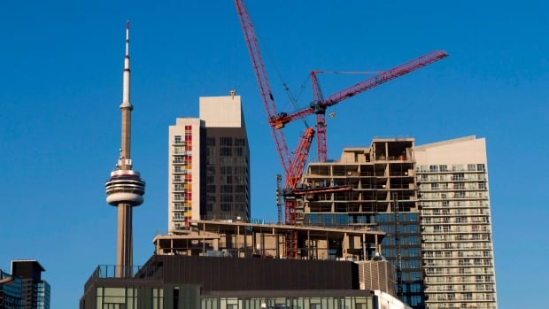 Construction cranes are seen in Toronto in July. The building boom continues with strong Toronto housing from the condo sector in November.