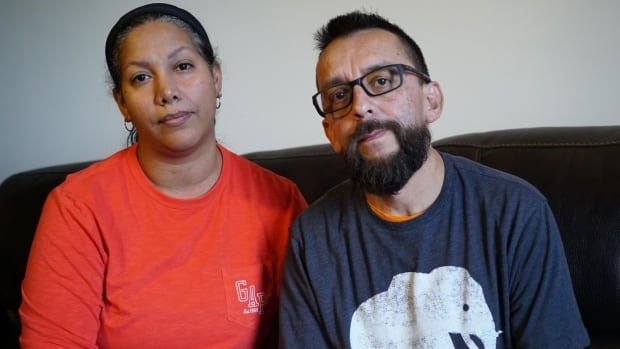 Mari Zambrano and Sergio Estepa in their home in St. Thomas, Ont., a day after they were attacked by a man wielding a baseball bat, yelling about ISIS and terrorists.