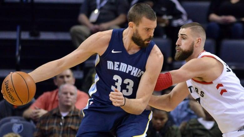 d53ebf372 Marc Gasol of the Memphis Grizzlies takes on Jonas Valanciunas of the  Toronto Raptors. (Brandon Dill Associated Press)