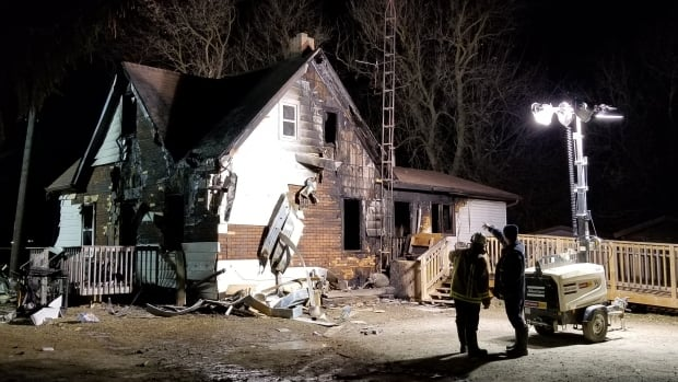 Six Nations Fire crew assess the scene of a house fire in Ohsweken, a village on the Six Nations of the Grand River reserve, on Friday.