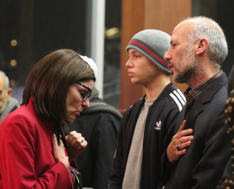 Yosif's father, Majed Al-Hasnawi, right, talks to MP Filomena Tassi at a  December memorial. (Laura Clementson/CBC)