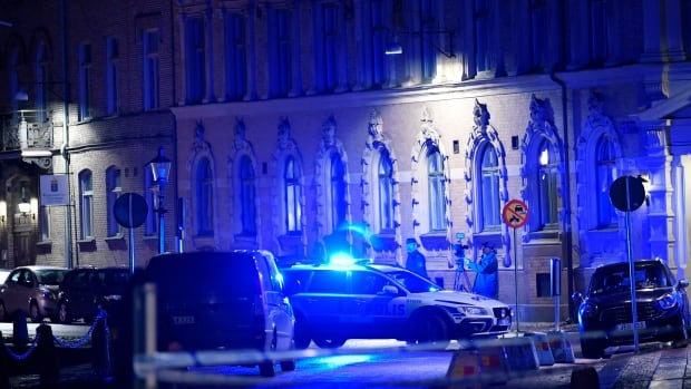 The site where a synagogue was attacked in Gothenburg, Sweden, is pictured late on Saturday. Three people have been arrested over the incident, police say.