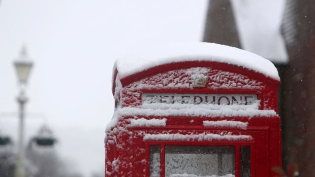 A snow covered phone box in Marlow, England, after heavy snow fell across parts of the United Kingdom on Sunday.