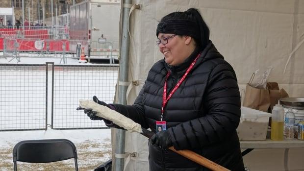 Tina Mark-Ottereyes of Toronto restaurant Tea-N-Bannock wraps bannock dough around a stick during Flavours of the North in Ottawa on Dec. 10, 2017.