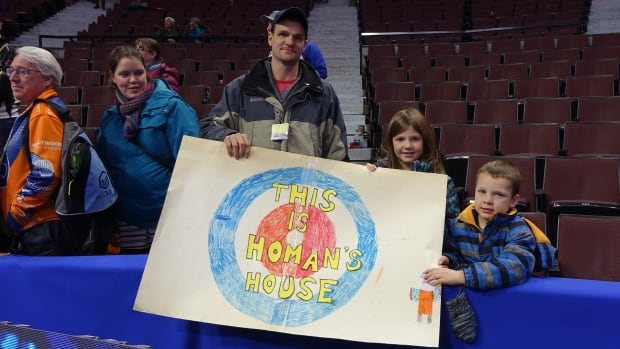 Hailey Peters, age 8 , and Elliott Peters, age 5, hold up their Roar of the Rings sign at the Canadian Tire Centre.