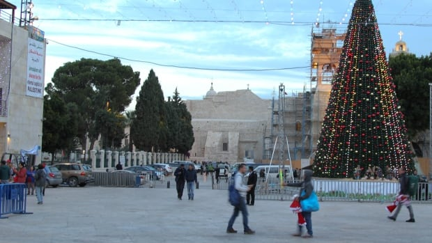 Manger Square in Bethlehem, located near the Church of the Nativity, had no Christmas lights for three days after U.S. President Donald Trump declared that the U.S. would recognize Jerusalem as the capital of Israel. The declaration is impacting tourism in Bethlehem.
