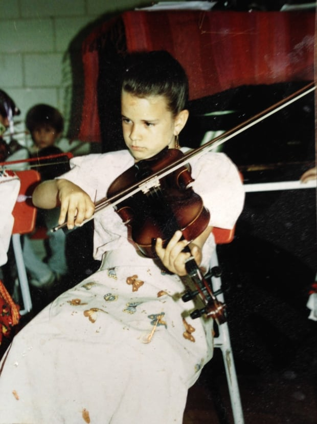 Young Miranda Currie playing violin