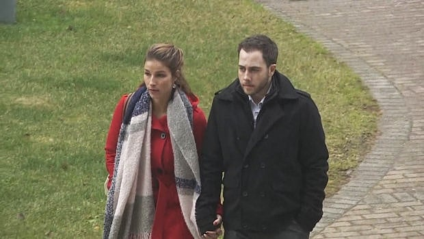 Christopher Garnier, right, heading to court Monday with his girlfriend, Brittany Francis.