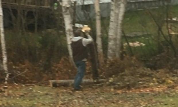 Man outside woman