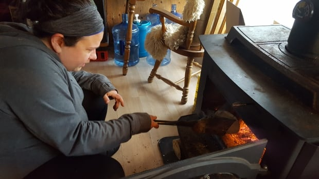 Miranda Currie tends her stove