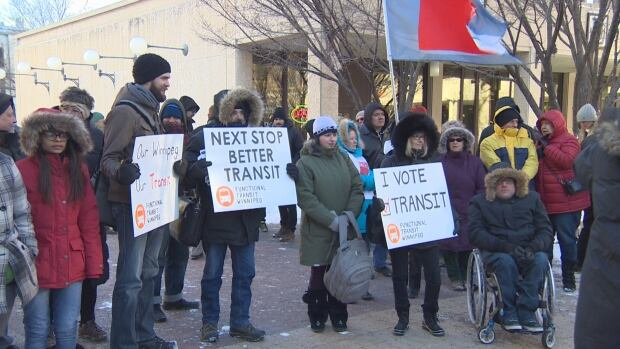 Protesters gather outside Winnipeg city hall Monday in hopes city council will find a way to avoid raising transit fares 25 cents.